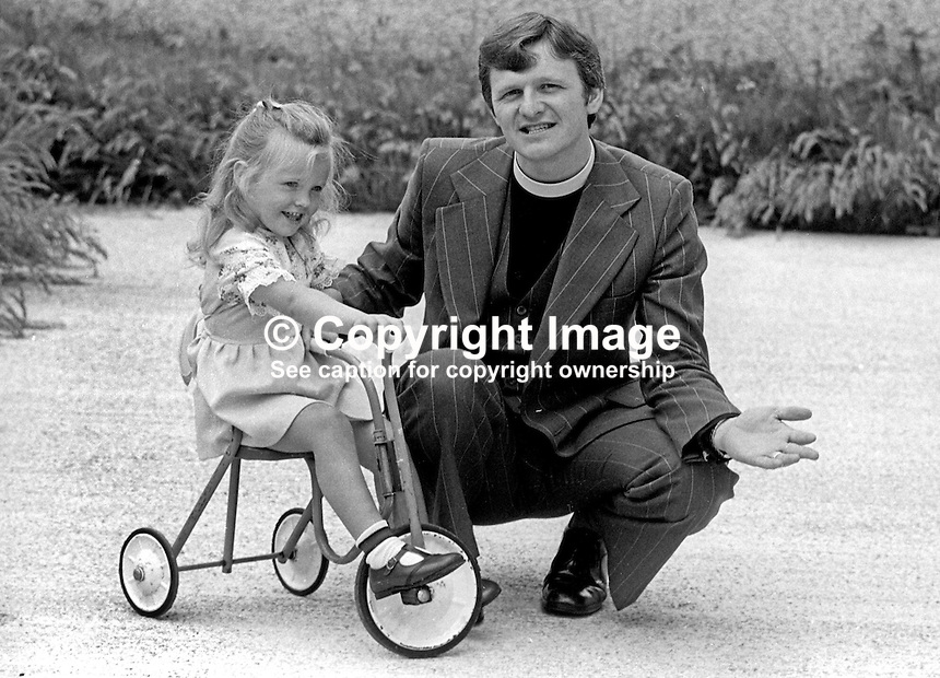 Rev William McCrea, minister, Free Presbyterian Church, Magherafelt, N Ireland, UK, pictured with his 4 years old daughter, Sharon, on 20th June 1976. Later he became prominent in local politics, then in N Ireland politics, and finally as the MP for Mid-Ulster in the UK Parliament at Westminster. He was a well-known as a gospel singer and has several albums to his name. 197606200390a<br /> <br /> Copyright Image from Victor Patterson, 54 Dorchester Park, Belfast, UK, BT9 6RJ<br /> <br /> Tel: +44 28 9066 1296<br /> Mob: +44 7802 353836<br /> Voicemail +44 20 8816 7153<br /> Skype: victorpattersonbelfast<br /> Email: victorpatterson@me.com<br /> Email: victorpatterson@ireland.com (back-up)<br /> <br /> IMPORTANT: If you wish to use this image or any other of my images please go to www.victorpatterson.com and click on the Terms &amp; Conditions. Then contact me by email or phone with the reference number(s) of the image(s) concerned.