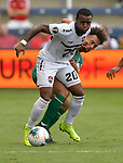 Jomal Williams (20) of Trinidad and Tobago (left) and Samuel Cox (8) of Guyana vie for the ball during their Gold Cup match on June 26, 2019 at Children's Mercy Park in Kansas City, KS.<br /> Tim VIZER/AFP