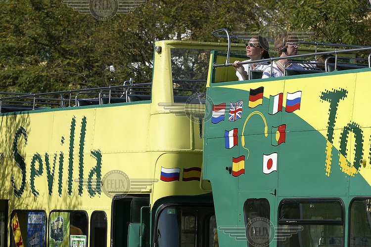 Tourists on a sightseeing bus. Seville, Andalusia, Spain, Europe.