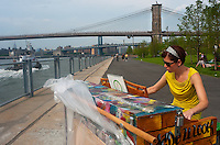 "New York, NY -  26 June 2010 Woman playing a (Baldwin) piano named Mertyl in Brooklyn Bridge Park..Play Me I'm Yours"" is a musical installation by British artist Luke Jerram who has been touring the project globally since 2008. From 9am-10pm each day, 60 pianos will be available to play across New York City. Presented by Sing for Hope they are located in public parks, streets and plazas the pianos will be available until 5th July for any member of the public to play and engage with."