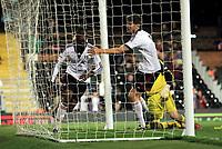 Moussa Dembele scores and celebrates scoring Fulham's opening goal