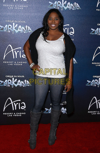 Shar Jackson.Red Carpet Premiere of Zarkana by Cirque Du Soleil at Aria Resort and Casino, Las Vegas, Nevada, USA, .9th November 2012..full length jeans white top grey gray knee high boots hand on hip .CAP/ADM/MJT.© MJT/AdMedia/Capital Pictures.