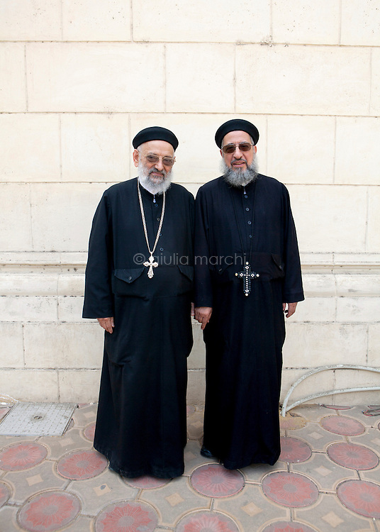 Egypt / Cairo / 4.11.2012 / Coptic Pope election: two priests pose during the Papal election ceremony in St Mark Cathedral in Abbasseya © Giulia Marchi