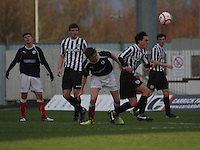 Anton Brady wins the ball from Ryan Blair at the Falkirk v St Mirren  Scottish Football Association Youth Cup 4th Round match played at the Falkirk Stadium, Falkirk on 16.12.12.