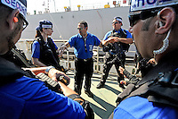 Trainees listen to an Israeli instructor as they take part in a training course to fight maritime terror and piracy, on a boat in Haifa Port....