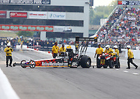 Sep 28, 2013; Madison, IL, USA; Safety Safari members help NHRA top fuel dragster driver Luigi Novelli off the track during qualifying for the Midwest Nationals at Gateway Motorsports Park. Mandatory Credit: Mark J. Rebilas-