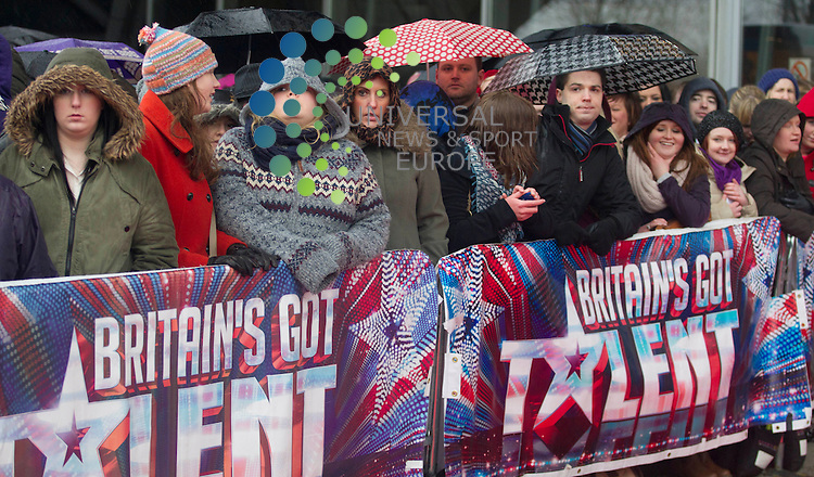 Britains Got Talent fans arrive just before the weather breaks and driving rain at the SECC in Glasgow to start the Scottish leg of the show..Universal News And Sport (Scotland). 28 January 2013 www.unpixs.com.