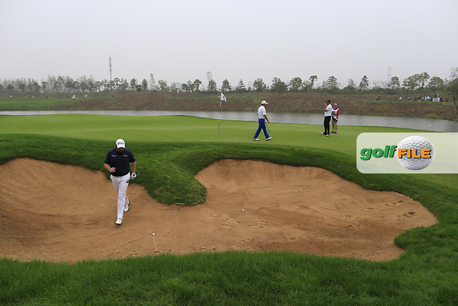 Shane Lowry (IRL) in a bunker at the 17th green during Saturay's Round 3 of the 2014 BMW Masters held at Lake Malaren, Shanghai, China. 1st November 2014.<br /> Picture: Eoin Clarke www.golffile.ie