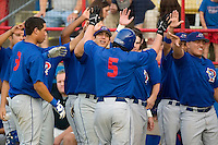 Pulaski's Baron Frost (5) is congratulated by his teammates following his solo  at Burlington Athletic Park in Burlington, NC, Saturday, July 29, 2006.  The Indians defeated the Blue Jays by the score of 8-4.