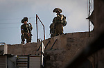 Israeli soldiers on the roofs on the Palestinian market.<br /> Hebron is a West Bank city that belongs to the Palestinian National Authority, about 400 Jewish settlers remain in some streets of the old town protected by some 2,000 Israeli soldiers.
