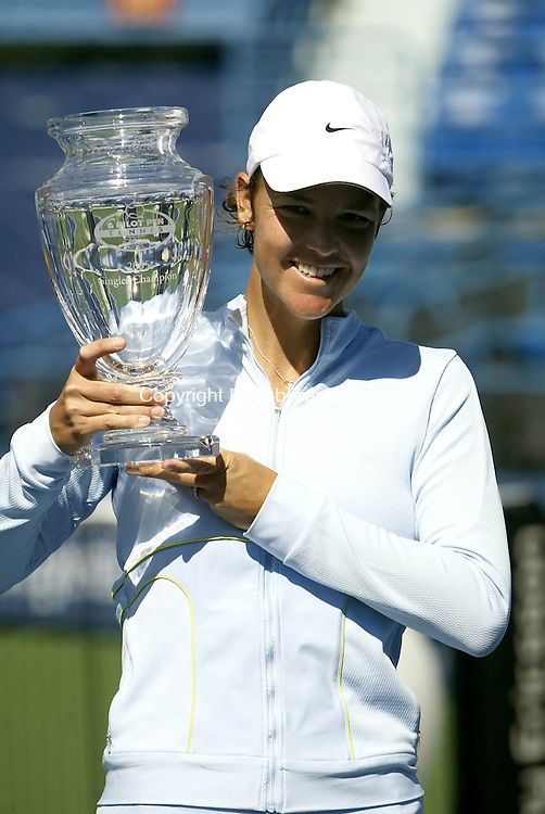 NEW HAVEN, CT--27 AUGUST 2005- 082705JS01--Lindsay Davenport (USA) holds the championship trophy after defeating Amelie Mauresmo (FRA) 6-4, 6-4 in the women's final of the Pilot Pen Tennis Tournament Saturday in New Haven.   Jim Shannon / Republican American--New Haven; Pilot Pen; New Haven; Pilot Pen; Lindsay Davenport, Amelie Mauresmo are CQ