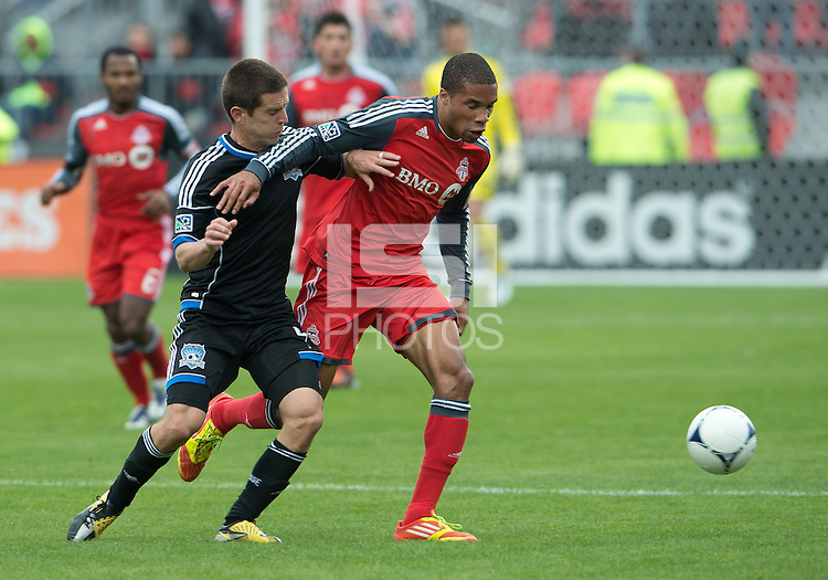 24 March 2012: San Jose Earthquakes midfielder Sam Cronin #4 and Toronto FC foward/midfielder Ryan Johnson #9 in action during the second half in a game between the San Jose Earthquakes and Toronto FC at BMO Field in Toronto..The San Jose Earthquakes won 3-0..