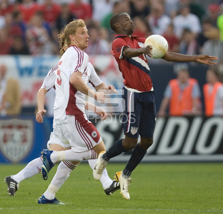 DaMarcus Beasley of the USA traps the ball against Juris Laizans of Latvia at Rentschler Field, East Hartford, CT, May 28, 2006. The USA won 1-0.