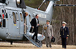 French President Francois Hollande with German Chancellor Angela Merkel arrives at the Operational Centre of the rescue operations of the crash of the Germanwings Airplane A320 in Seyne les Alpes, France on March 25, 2015.