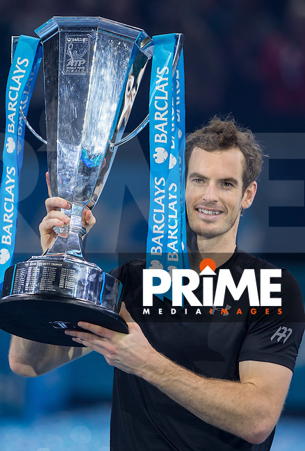 Andy Murray celebrates with the 2016 ATP London winner trophy during the Barclays ATP World Tour Finals FINAL match between ANDY MURRAY and NOVAK DJOKOVIC at the O2, London, England on 20 November 2016. Photo by Andy Rowland.