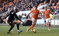Blackpool's John O'Sullivan under pressure from  Barnsley's Ethan Pinnock<br /> <br /> Photographer Rich Linley/CameraSport<br /> <br /> The EFL Sky Bet League One - Blackpool v Barnsley - Saturday 22nd December 2018 - Bloomfield Road - Blackpool<br /> <br /> World Copyright &copy; 2018 CameraSport. All rights reserved. 43 Linden Ave. Countesthorpe. Leicester. England. LE8 5PG - Tel: +44 (0) 116 277 4147 - admin@camerasport.com - www.camerasport.com