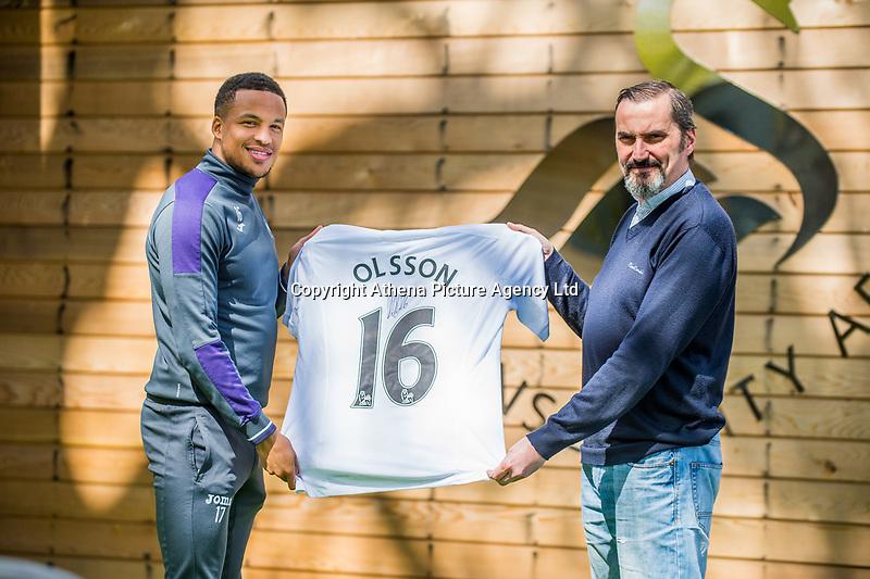 (L-R) Martin Olsson with club sponsor, photographer Dimitris Legakis at The Fairwood training Ground, Swansea, Wales, UK. Tuesday 25 April 2017
