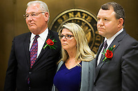 TALLAHASSEE, FLA. 3/4/14- Diena Thompson, center left, mother of 7-year-old Somer Thompson who was abducted and killed in 2009 in Orange Park, is flanked by Sen. Greg Evers, R-Baker, left and Sen. Rob Bradley, R-Fleming Island, right, during a news conference after the Senate passed a package of bills to strengthen laws against sex offenders during opening day of the legislative session, March 4, 2014 at the Capitol in Tallahassee. Bradley sponsored a bill to increase the length of sentences for certain adult-on-minor sex crimes and Evers sponsored a bill enhancing sex offender registry requirements.<br /> <br /> COLIN HACKLEY PHOTO