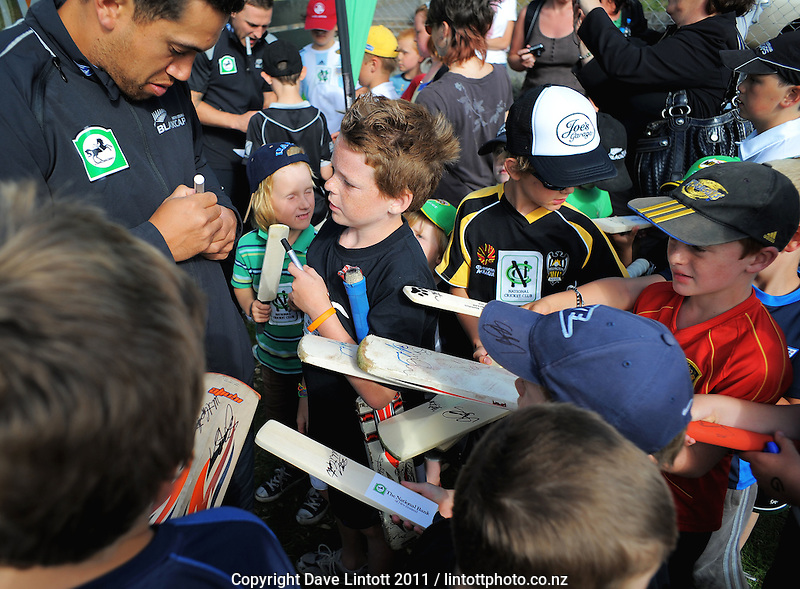 Ross Taylor signs autographs. NCC cricket supercamp at Anderson Park, Wellington, New Zealand on Thursday, 13 January 2011. Photo: Dave Lintott / lintottphoto.co.nz