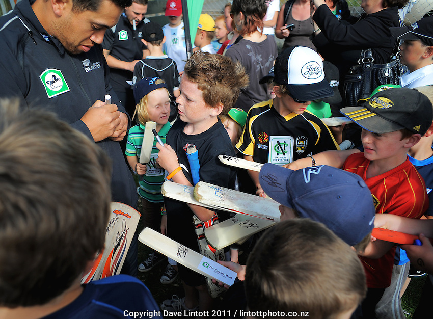 Ross Taylor signs autographs. NCC cricket supercamp at Anderson Park, Wellington, New Zealand on Thursday, 13 January 2011. Photo: Dave Lintott / lintottphoto.co.nz