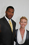 Michael Strahan (Brothers & football player) poses with Kelli Giddish (AMC & new show Past Life) at the FOX 2009 Programming Presentation (Upfronts) Post-Party on May 18, 2009 at Wollman Rink in Central Park, New York City, New York.  (Photo by Sue Coflin/Max Photos)