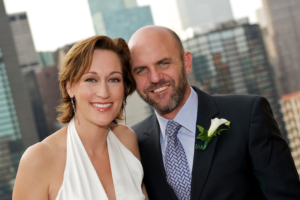 Closeup portrait of bride and groom.