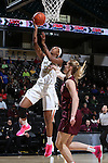 25 February 2016: Wake Forest's Milan Quinn (32) and Virginia Tech's Regan Magarity (SWE) (right). The Wake Forest University Demon Deacons hosted the Virginia Tech Hokies at Lawrence Joel Veterans Memorial Coliseum in Winston-Salem, North Carolina in a 2015-16 NCAA Division I Women's Basketball game. Virginia Tech won the game 54-48.