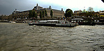 The Mused de O'rsay with and  a sight seeing boat on the river Seine. Paris, France