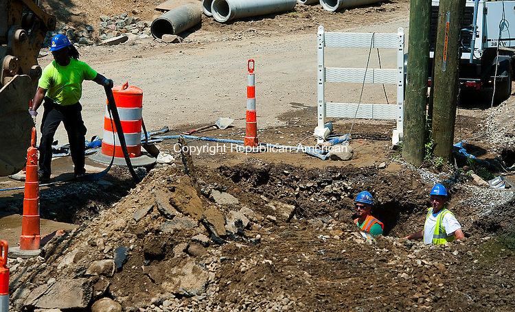 OXFORD, CT-060414JS04--Workers from Guerrera Construction Company, Inc., finish repairing a water main break on Christian Street and Commerce Drive in Oxford on Tuesday.<br /> Jim Shannon Republican-American