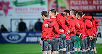 Lincoln City players during a minutes silence in memory of those who lost their life in the recent New Zealand terror attack<br /> <br /> Photographer Chris Vaughan/CameraSport<br /> <br /> The EFL Sky Bet League Two - Mansfield Town v Lincoln City - Monday 18th March 2019 - Field Mill - Mansfield<br /> <br /> World Copyright © 2019 CameraSport. All rights reserved. 43 Linden Ave. Countesthorpe. Leicester. England. LE8 5PG - Tel: +44 (0) 116 277 4147 - admin@camerasport.com - www.camerasport.com