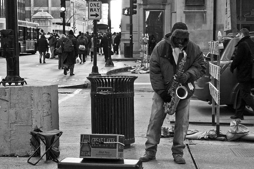 Photo made on a downtown Chicago street on a cold spring day 2011. He was positioned not far from the commuter train station.