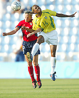 14 August 2004:   USA Kristine Lilly battles for the ball in the air against Elaine from Brazil at Kaftanzoglio Stadium in Thessaloniki, Greece.   USA defeated Brazil, 2-0. Credit: Michael Pimentel / ISI