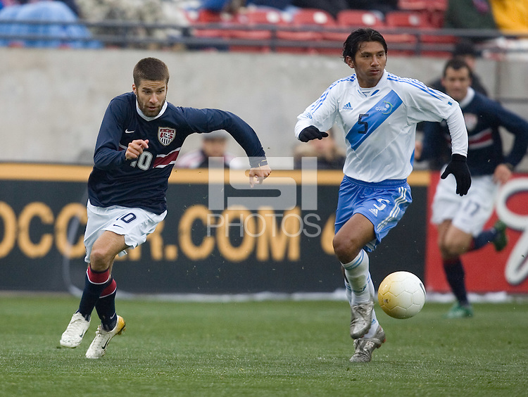 Kyle Martino tries to beat Henry Medina to the ball at Pizza Hut Park in Frisco, Texas, Sunday, Feb. 19, 2005.  USA won 4-0.
