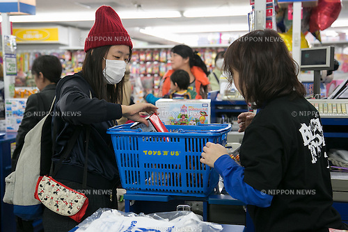 Customers wait in a checkout line on Black Friday at a Toys''R''Us and Babies''R''Us retail store in Sunshine City commercial complex in Ikebukuro on November 25, 2016, Tokyo, Japan. Black Friday deals have only started coming to Japan in recent years and the store has discounts of up to 83% on some products up until November 27. (Photo by Rodrigo Reyes Marin/AFLO)
