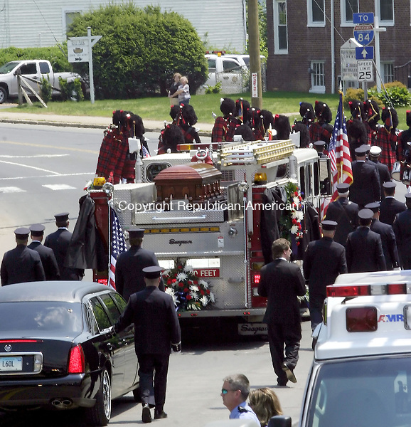 WATERBURY, CT -25 MAY 2007 - -052507DA03--The Waterbury fire truck engine 7, carrying the body of Capt. John Keane, passes along East Main Street, after leaving a Mass at SS. Peter and Paul Church in Waterbury Friday. The procession  followed to Calvary Cemetery where Keane will be laid to rest. <br />  Darlene Douty/Republican-American