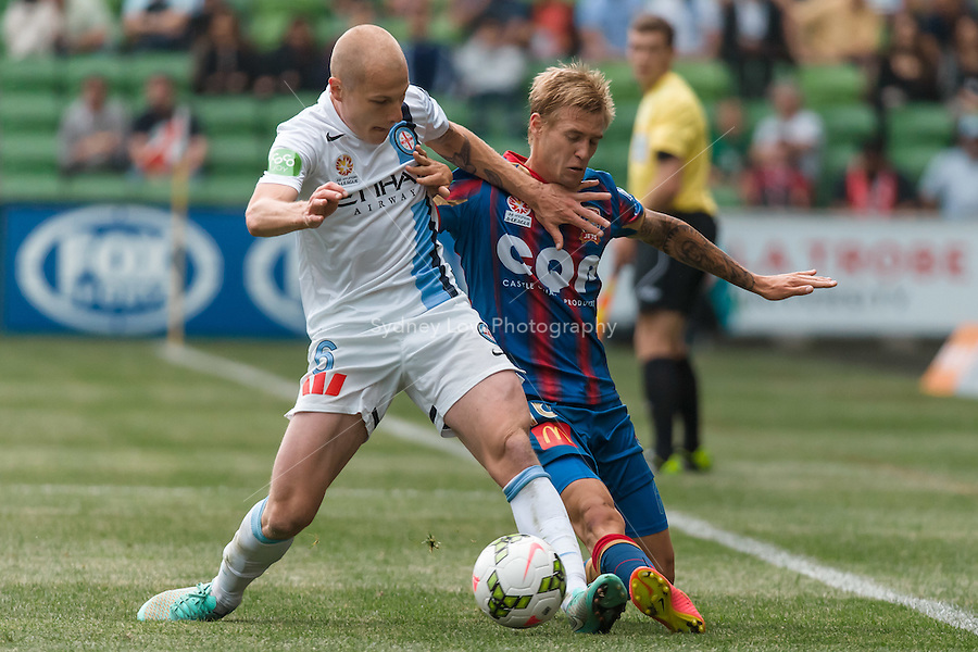 Aaron MOOY of Melbourne City and Jacob PEPPER of the Jets compete for the ball in the round 2 match between Melbourne City and Melbourne Victory in the Australian Hyundai A-League 2014-15 season at AAMI Park, Melbourne, Australia.