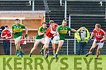 Kerry Barry John Keane is fouled by Ian Mcguire Cork as he shoots for a point during the McGrath cup clash in Mallow on Sunday