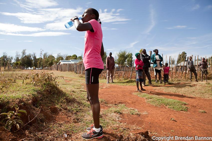 Florence Kiplagat prepares for a morning training session in Kaplelach, Kenya near Eldoret.