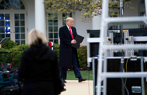 United States President Donald Trump arrives to participate in a Fox News Virtual Town Hall with Anchor Bill Hemmer, in the Rose Garden of the White House in Washington, DC, Tuesday, March, 24, 2020. <br /> Credit: Doug Mills / Pool via CNP