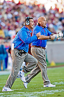 November 27, 2010:   Florida Gators head coach Urban Meyer and  Offensive Coordinator Steve Addazio run out on the field trying to get the attention of their team during  first half game action between the ACC Conference Florida State Seminoles and the SEC Conference University of Florida Gators at Doak Campbell Stadium in Tallahassee, Florida.