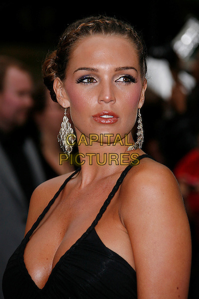 DANIELLE LLOYD.'Transformers: Revenge of the Fallen' .UK film premiere at Odeon cinema, Leicester Square, London, England..15th June 2009.headshot portrait black cleavage dangling gold earrings braid plait hair .CAP/DAR.©Darwin/Capital Pictures.