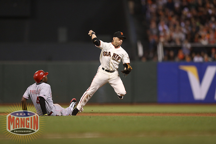 SAN FRANCISCO - OCTOBER 6:  Marco Scutaro of the San Francisco Giants makes a play at second base during Game 1 of the NLDS against the Cincinnati Reds at AT&T Park on October 6, 2012 in San Francisco, California. (Photo by Brad Mangin)