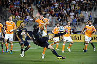 Sebastien Le Toux (9) of the Philadelphia Union attempts a bicycle  kick as Hunter Freeman (21) of the Houston Dynamo defends. The Philadelphia Union and the Houston Dynamo played to a 1-1 tie during a Major League Soccer (MLS) match at PPL Park in Chester, PA, on August 6, 2011.