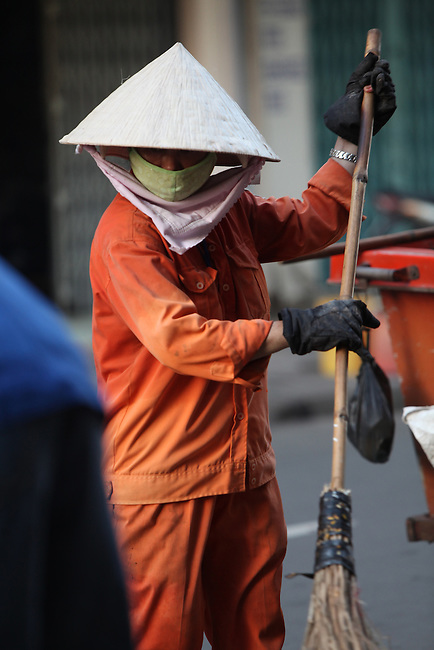 A street sweeper works in the early morning hours on Bui Vien Street in Ho Chi Minh City, Vietnam. Aug. 18, 2011.