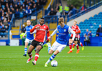 Sheffield Wednesday's defender Joost Van Aken (4) passes back to his keeper under pressure from Barnsley's forward Mamadou Thiam (26) during the Sky Bet Championship match between Sheff Wednesday and Barnsley at Hillsborough, Sheffield, England on 28 October 2017. Photo by Stephen Buckley / PRiME Media Images.