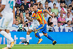 Simone Zaza (r) of Valencia CF competes for the ball with Marco Asensio Willemsen of Real Madrid during their La Liga 2017-18 match between Real Madrid and Valencia CF at the Estadio Santiago Bernabeu on 27 August 2017 in Madrid, Spain. Photo by Diego Gonzalez / Power Sport Images