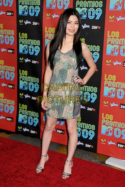 MIRANDA COSGROVE .MTV Los Premios Awards 2009 held at the Gibson Amphitheatre, Universal City, California, USA, 15th October 2009..full length grey gray green beaded sleeveless dress ankle strap sandals  bronze jewel crystals encrusted jewelled  hand on hip .CAP/ADM/BP.©Byron Purvis/Admedia/Capital Pictures