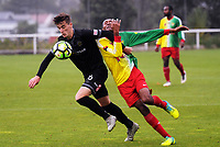 Mosie Milumbwa fouls Team Wellington's Angus Kilkolly (left) during the 2018 OFC Champions League Quarterfinal between Team Wellington and Lae City Dwellers FC at David Farrington Park in Wellington, New Zealand on Saturday, 7 April 2018. Photo: Dave Lintott / lintottphoto.co.nz
