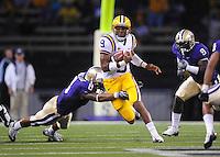 Sept. 5, 2009; Seattle, WA, USA; LSU Tigers quarterback (9) Jordan Jefferson runs the ball in the first quarter past diving Washington Huskies safety (8) Nate Williams at Husky Stadium. Mandatory Credit: Mark J. Rebilas-