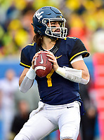 Morgantown, WV - NOV 18, 2017: West Virginia Mountaineers quarterback Will Grier (7) sits back in the pocket during game between West Virginia and Texas at Mountaineer Field at Milan Puskar Stadium Morgantown, West Virginia. (Photo by Phil Peters/Media Images International)